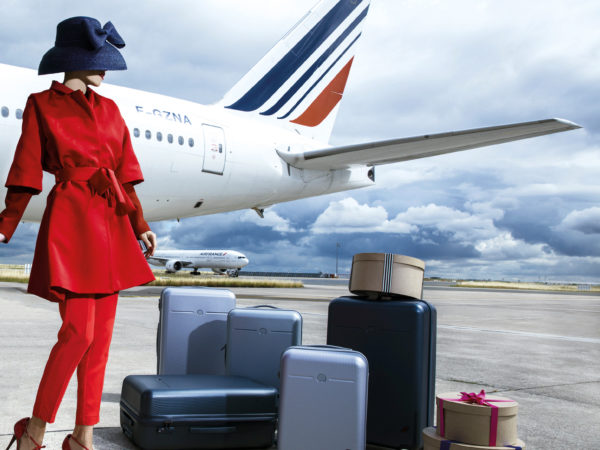 Suitcases in front of Air France Boeing 777