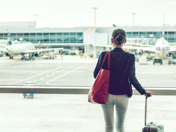 Woman with hard shell bag at an airport