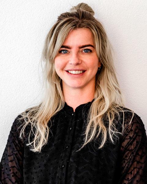 business woman blondine wearing a black blouse